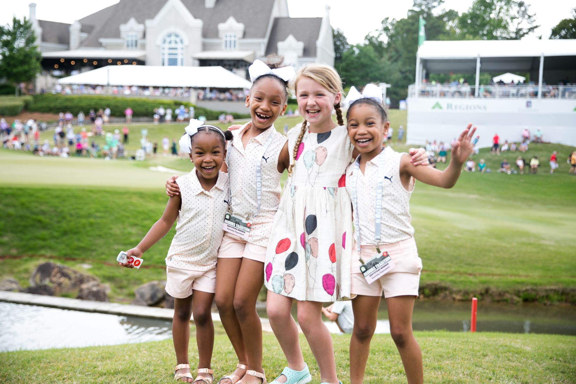 Young girls smiling in a group shot at the 2021 Regions Tradition at Greystone. hoto credit Grace Vroom, Bruno Events