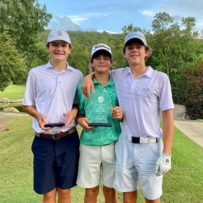 Chase Kyes with golfing award and young golfers – Greystone