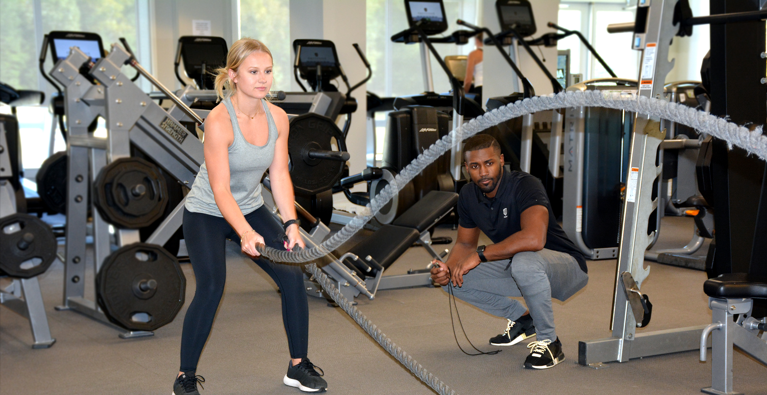 Fitness Training at Greystone - woman rope training with male trainer