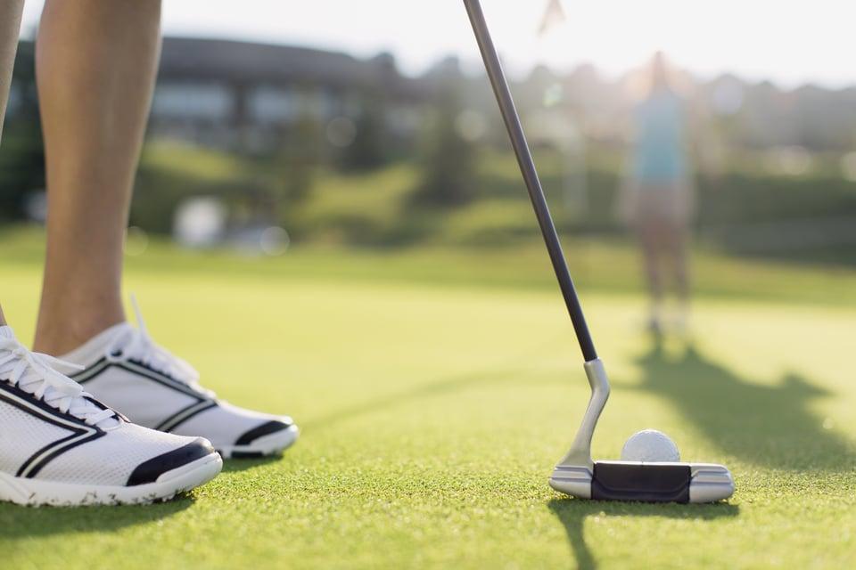 putting on a green - golf performance center